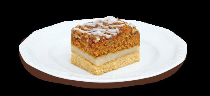 Kawałek ciasta miodowo-orzechowego na talerzyku