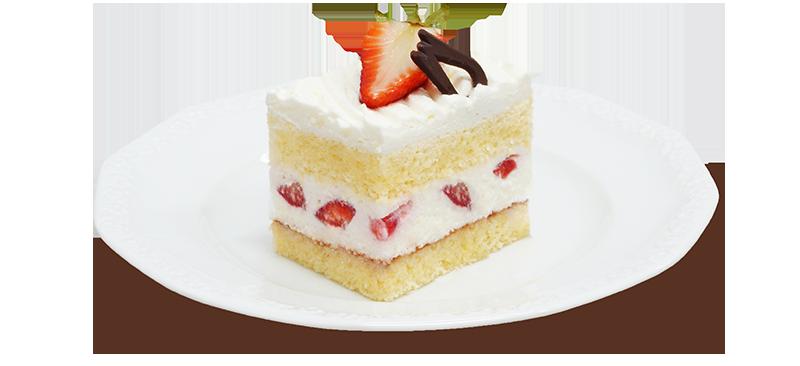 Kawałek ciasta z truskawkami na talerzyku