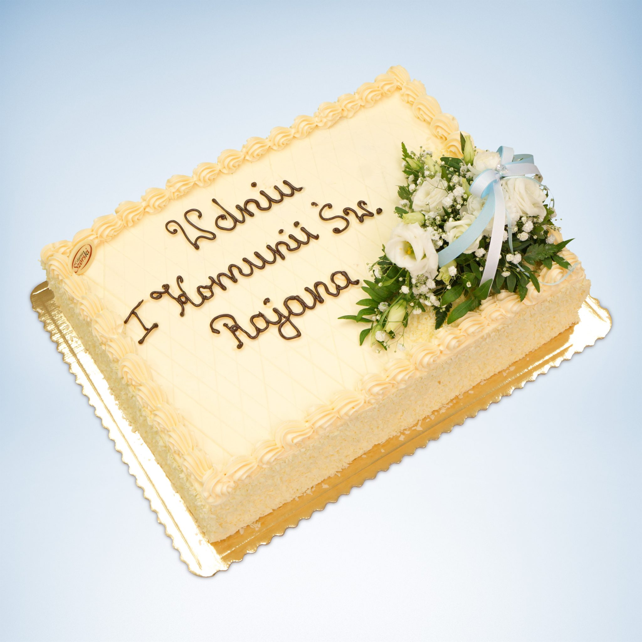 Prostokątny tort na komunię z kwiatami