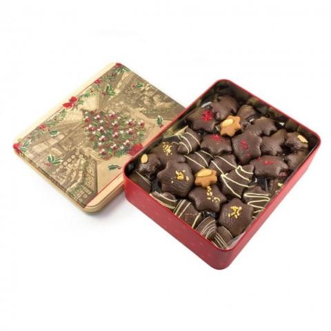 """Puszka """"Nostalgia"""" Puszka z dekorowanymi piernikami w czekoladzie deserowej z malinami, migdałami i białą czekoladą."""